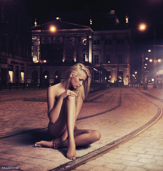 stockfresh 724117 young-woman-in-sensual-pose-on-the-street size