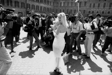 Caption:ROME ITALY - JUNE 2: The porn star in art Cicciolina candidate for the Radical Party surrounded by photographers during the election campaign for the parliamentary elections on June 2 1987 in Rome Italy.(Photo by Stefano Montesi - Corbis/Getty Images)
