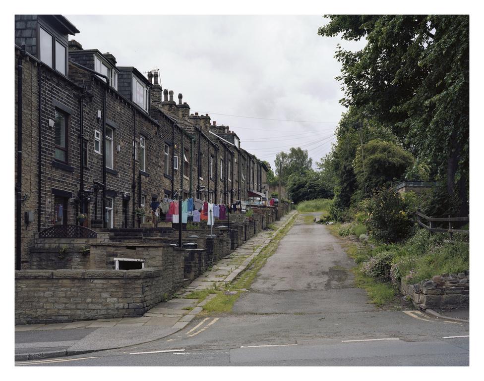 A Saltaire Mill munkáslakásai, melyek az adott kor legjobb körülményeit biztosították, a nagyvárosokban található nyomornegyedekhez képest.                         Saltaire, Bradford, Anglia.