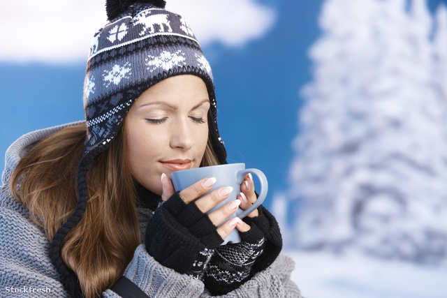stockfresh 624069 pretty-girl-drinking-hot-tea-in-winter-eyes-cl