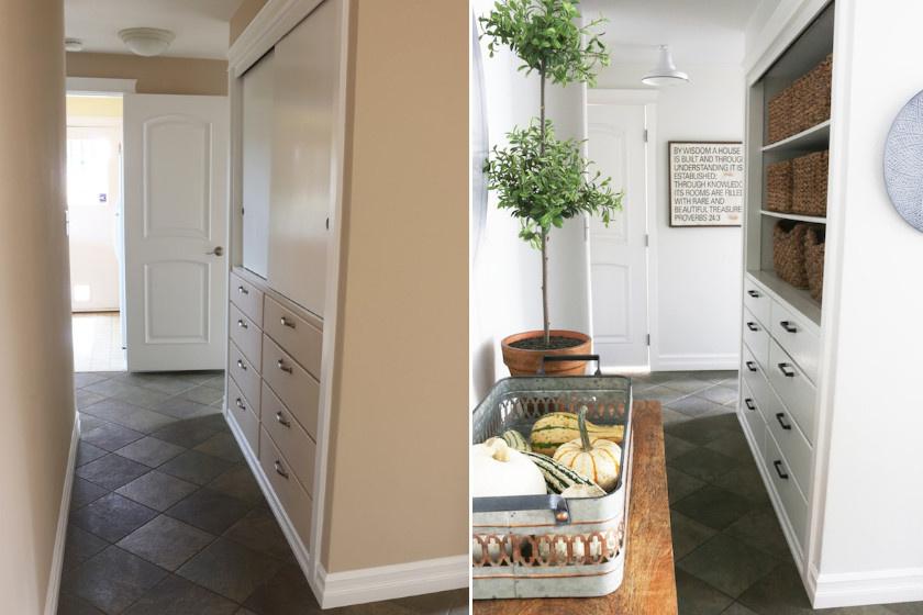 A falak fehérre festése után az előszoba optikailag nagyobbnak tűnik, noha plusz egy bútor is bekerült. Remek ötlet volt a szekrény felső felének megnyitása is, melybe trendi kosarakat tettek. A falikép, a növény és a dekoráció barátságossá tette a helyiséget.