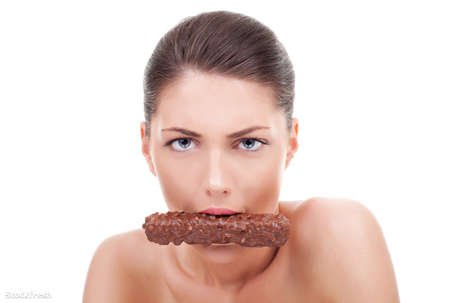 stockfresh 1718554 serious-woman-eating-chocolate-bar sizeM