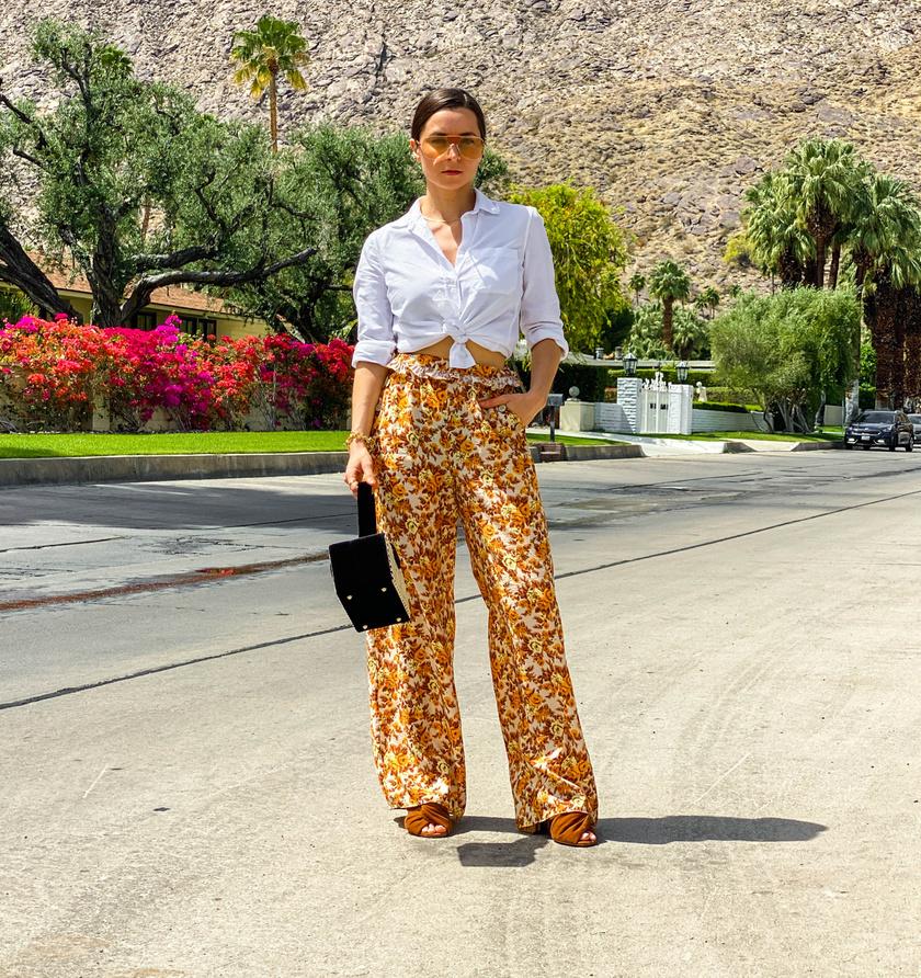 A lenge, kényelmes, mégis nőies, bő szárú nadrágok a nyár óriási kedvencei. Tovább fokozhatod a csinos összhatást, ha fehér inggel párosítod őket.