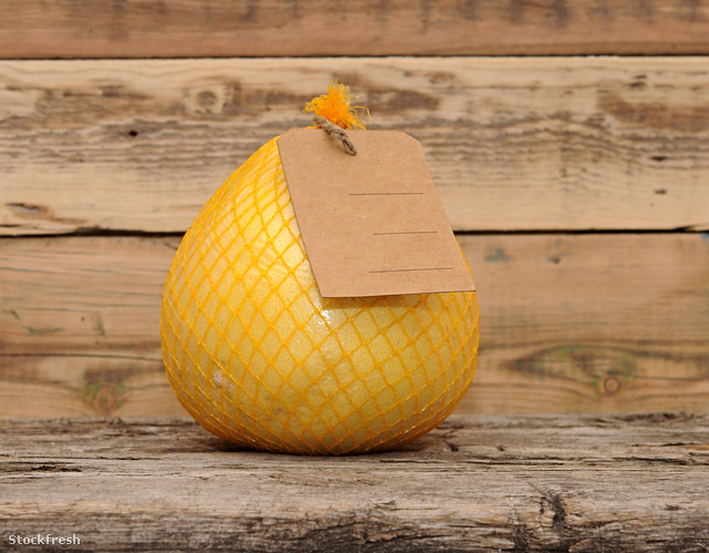stockfresh 2405854 pomelo-fruit-with-blank-price-tag-wrapped-in-