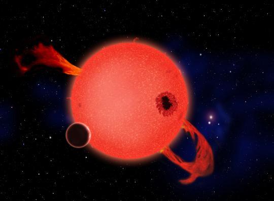 Fantáziakép egy aktív vörös törpe körül keringő bolygóról. A fiatal vörös törpecsillagok gyakran mutatnak hatalmas kitöréseket erős ultraibolya sugárzás kíséretében. Az aktivitás később azonban jelentős mértékben csökken.