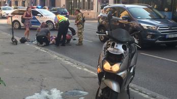Baleset Óbudán: berepült a motoros az autó hátsó ablakán