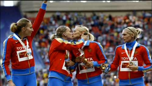 Two-Female-Russian-Athletes-Kiss-on-Winners-Podium-AOL-On