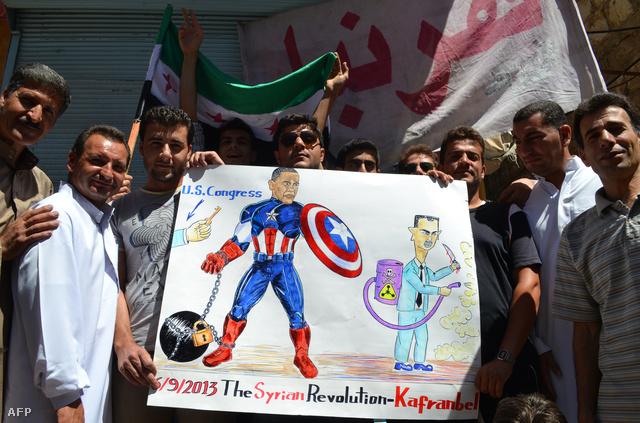 Szíriai tüntetők egy nyugatnak szánt karikatúrával a kezükben