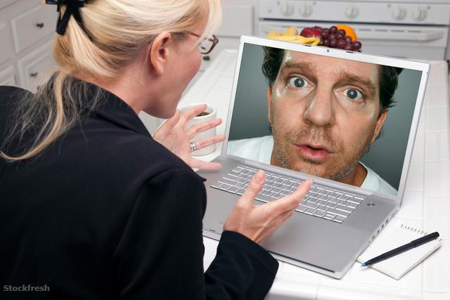 stockfresh 1302999 excited-woman-in-kitchen-using-laptop---intru