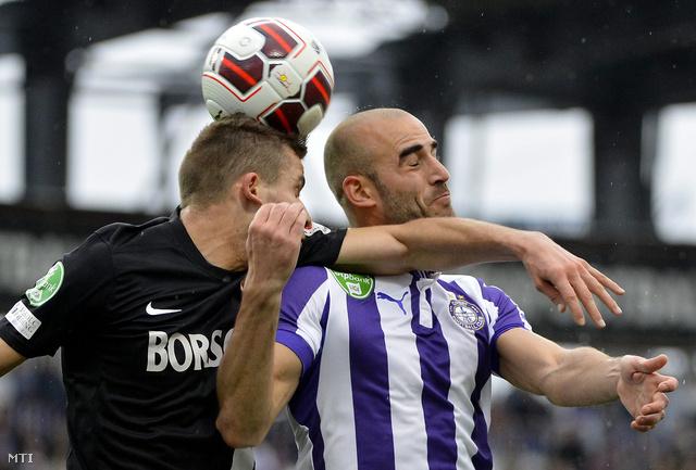 Eperjesi Gábor a Diósgyőr és Steve Jonathan Heris az Újpest játékosa az OTP Bank Liga 21. fordulójában játszott Újpest - Diósgyőr bajnoki labdarúgó-mérkőzésen.
