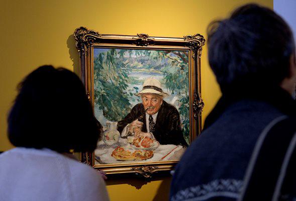Csók István Keresztapa reggelije című festménye (Fotó: Bruzák Noémi, MTI)